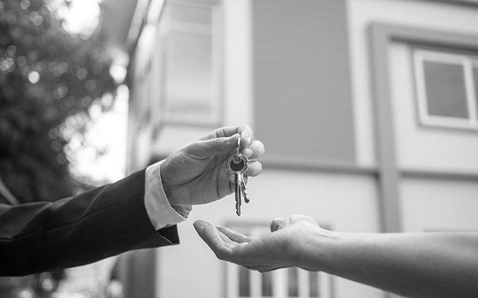 agent handing customer keys to new home